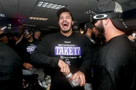DENVER, CO - SEPTEMBER 30:  Nolan Arenado #28 of the Colorado Rockies celebrates in the lockerroom at Coors Field on September 30, 2017 in Denver, Colorado. Although losing 5-3 to the Los Angeles Dodgers, the Rockies celebrated clinching a wild card spot in the post season. (Photo by Matthew Stockman/Getty Images)