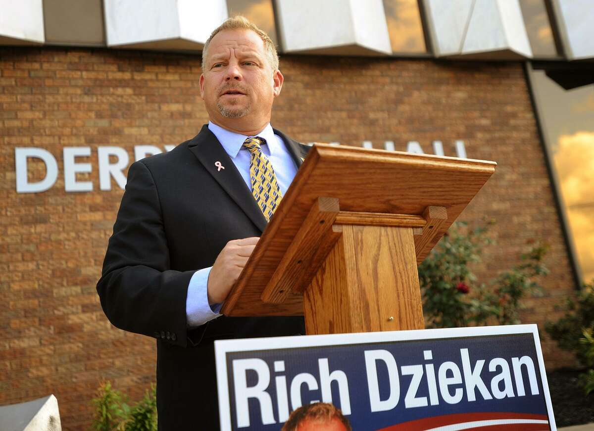 Republican candidate for mayor Rich Dziekan discusses the city's finances and risk of a Standard and Poors downgrade outside City Hall in Derby, Conn. on Tuesday, October 3, 2017.