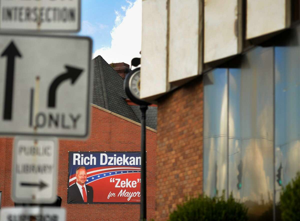 A large campaign poster for Republican candidate for mayor Rich Dziekan faces the office of Mayor Anita Dugatto outside City Hall on Elizabeth Street in Derby, Conn. on Tuesday, October 3, 2017.