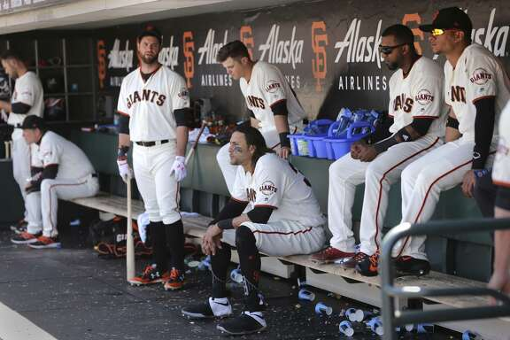 """Brandon Belt (with bat) led the Giants with 18 home runs in 2017. Considering the dimensions of AT&T Park, the Giants don't figure to become a team that relies on the long ball, but they could use a """"presence"""" in the middle of their lineup."""