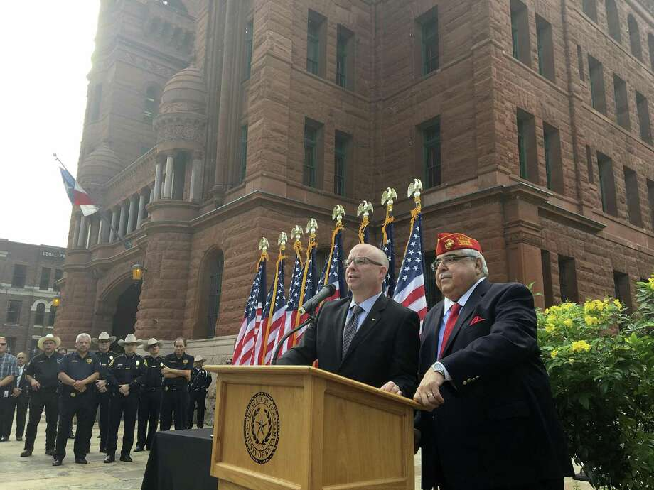 Bexar County Commissioners Kevin Wolff and Paul Elizondo speak at the unveiling of a plaque commemorating recipients of the Texas Legislative Medal of Honor. The two fought but became friends. Elizondo died recently. Photo: Jasper Scherer /San Antonio Express-News / San Antonio Express-News