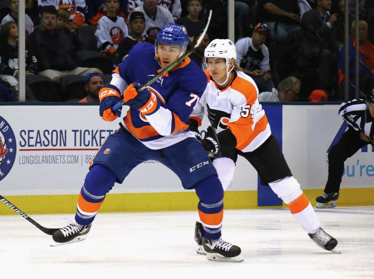 The Islanders' Michael Dal Colle skates against the Philadelphia Flyers during a preseason game at the Nassau Veterans Memorial Coliseum on Sept. 17 in Uniondale, N.Y.
