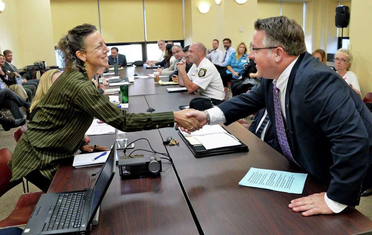 Dr. Daliah Heller, left, from the City University of New York is greeted by County Executive Dan McCoy during a meeting of the county opioid task force Tuesday Oct. 3, 2017 in Albany, NY. (John Carl D'Annibale / Times Union)