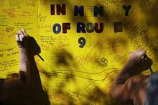 People leave messages at a makeshift memorial for victims of a shooting, Tuesday, Oct. 3, 2017, in Las Vegas. Authorities said Stephen Craig Paddock broke windows on the Mandalay Bay casino and began firing with a cache of weapons, killing dozens and injuring hundreds at the festival. (AP Photo/John Locher)