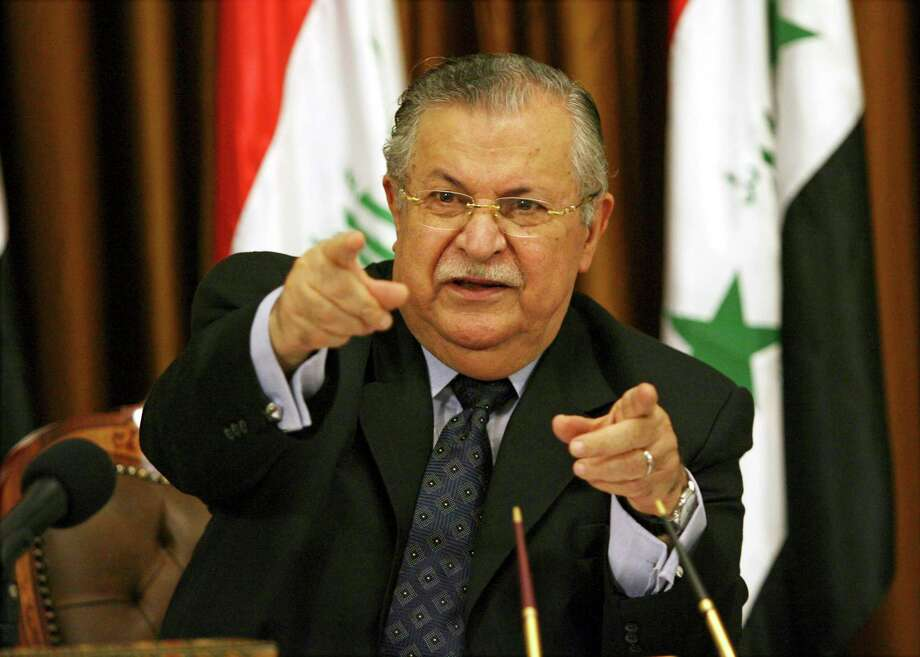 FILE - In this Aug. 17, 2007 file photo, then Iraqi President Jalal Talabani talks to reporters in Baghdad, Iraq. Talabani, a lifelong fighter for Iraq's Kurds who rose to become the country's president, presenting himself as a unifying father figure to temper the potentially explosive hatreds among Kurds, Shiites and Sunnis has died in a Berlin hospital at the age of 83. (AP Photo/ Hadi Mizban, File) Photo: Hadi Mizban, STF / Copyright 2017 The Associated Press. All rights reserved.