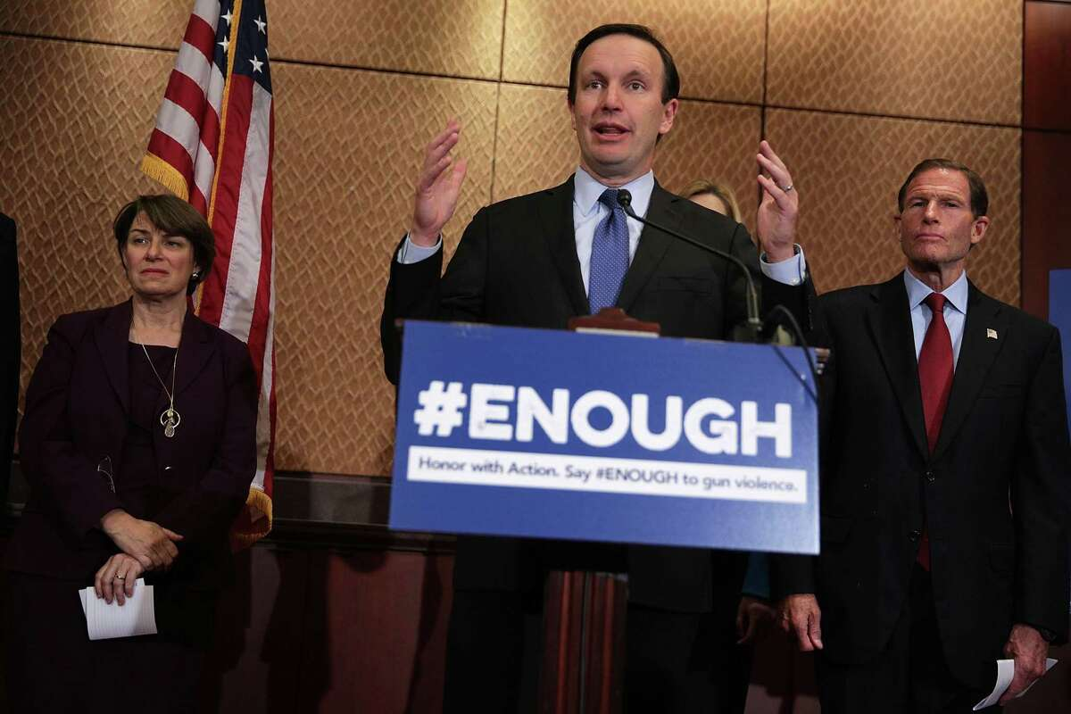 U.S. Sen. Chris Murphy (D-CT) (2nd L) speaks as Sen. Richard Blumenthal (D-CT) (R) and Sen. Amy Klobuchar (D-MN) (L) listen during a news conference October 3, 2017 on Capitol Hill in Washington, DC. Sen. Murphy and the Brady Campaign to Prevent Gun Violence held a news conference to demand that Congress take action to stop gun violence after the Las Vegas shooting.