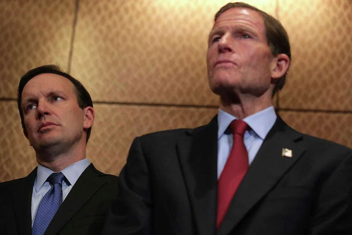 U.S. Sen. Chris Murphy (D-CT) (L) and Sen. Richard Blumenthal (D-CT) (R) listen during a news conference October 3, 2017 on Capitol Hill in Washington, DC. Sen. Murphy and the Brady Campaign to Prevent Gun Violence held a news conference to demand that Congress take action to stop gun violence after the Las Vegas shooting.