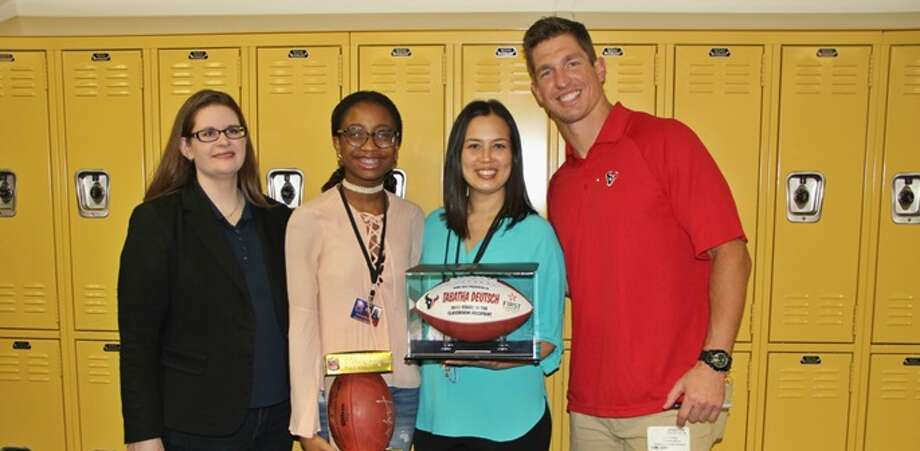 Pictured, from left, are Amber Magee, ImmanuellaEyobio, Tabetha Deutsch, and Texans player Brian Peters. Eyobio nominated Deutsch for the Stars in the Classroom program. Photo: Courtesy