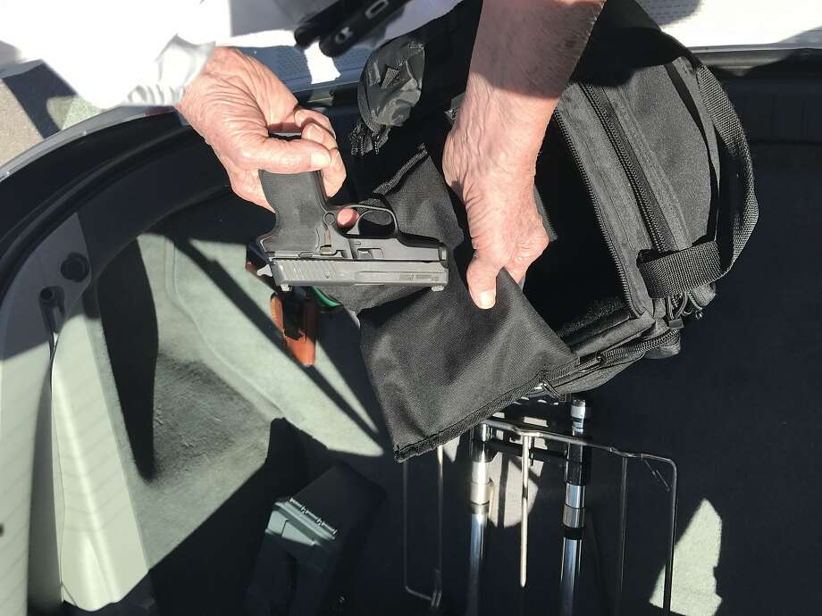 Art Hansborough, 78, of Las Vegas, shows off his guns and ammo outside The Range 702 in Las Vegas on Tuesday October 3, 2017. Photo: Evan Sernofsky / The Chronicle, Evan Sernoffsky / The Chronicle