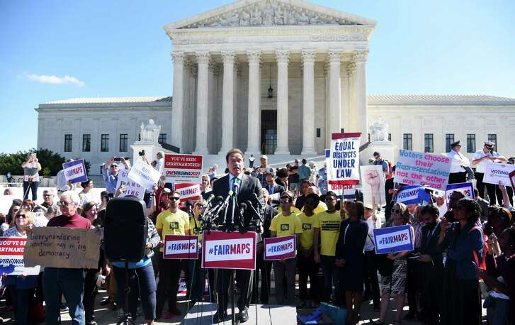 Former California Gov. Arnold Schwarzenegger speaks outside of the U.S. Supreme Court in Washington Tuesday after oral arguments in Gill v. Whitford to call for an end to partisan gerrymandering. (Photo by Olivier Douliery/Getty Images)