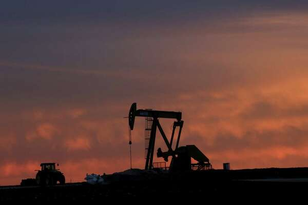 The clock is ticking on the drillers, frackers and refiners who drive the core of our economic engine. Some major oil and gas companies predict that demand for crude will peak as soon as the 2020s. (AP Photo/LM Otero)