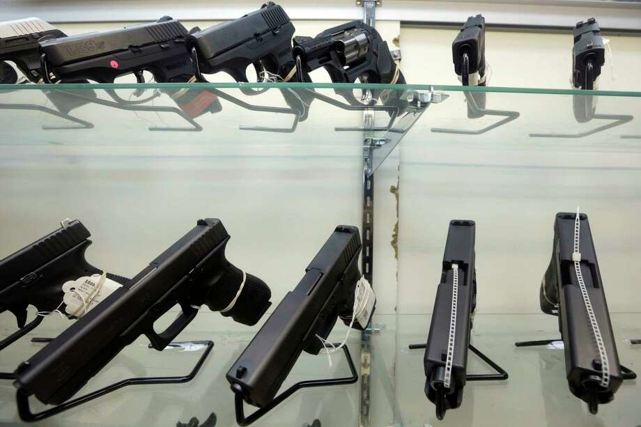 This Wednesday, June 29, 2016, photo shows guns on display at a gun store in Miami. After a gunman killed more than 50 people in Las Vegas in the nation's latest mass shooting, stocks in the gun industry rose, Monday, Oct. 2, 2017. (AP Photo/Alan Diaz) Photo: Alan Diaz, STF / Copyright 2016 The Associated Press. All rights reserved. This material may not be published, broadcast, rewritten or redistribu