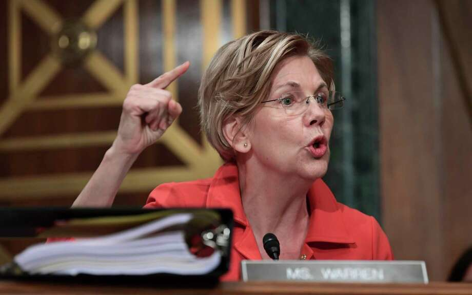 "In blistering criticism, Sen. Elizabeth Warren said Wells Fargo CEO Timothy Sloan was, at best ""incompetent"" and at worse ""complicit"" in the bank's culture that led to its fake-accounts scandal.  Photo: Susan Walsh, STF / Copyright 2017 The Associated Press. All rights reserved."