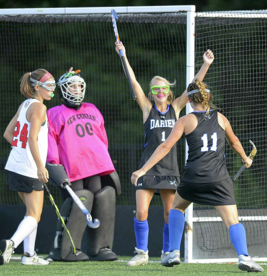 Darien's Molly Hellman (1) celebrates her first half goal against New Canaan goalie Emily Gaeta during an FCIAC girls field hockey rivalry match at Dunning Field in New Canaan, Connecticut on Tuesday, Oct. 3, 2017. Darien won 2-1. Photo: Matthew Brown / Hearst Connecticut Media / Stamford Advocate