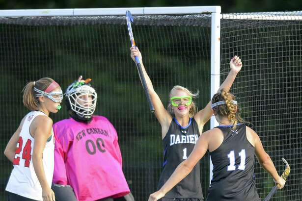 Darien's Molly Hellman (1) celebrates her first half goal against New Canaan goalie Emily Gaeta during an FCIAC girls field hockey rivalry match at Dunning Field in New Canaan, Connecticut on Tuesday, Oct. 3, 2017. Darien won 2-1.