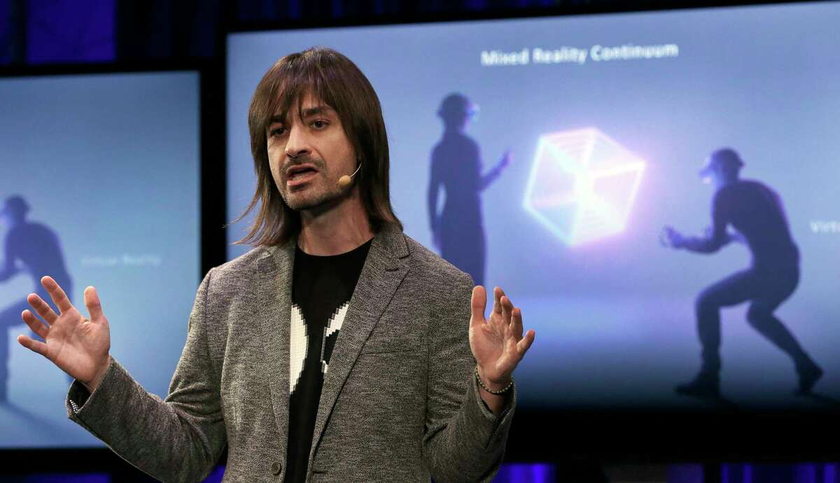Microsoft Technical Fellow Alex Kipman speaks during a media conference, Tuesday, Oct. 3, 2017, in San Francisco. Microsoft is touting virtual reality headsets made by other companies in hopes of establishing personal computers running on its Windows 10 operating system as the best way for people to experience artificial worlds. The devices unveiled on Tuesday include a Samsung headset called the HMD Odyssey. The $500 headset requires a connection to a PC running on a Windows 10 update being released Oct. 17. (AP Photo/Ben Margot) ORG XMIT: CABM102