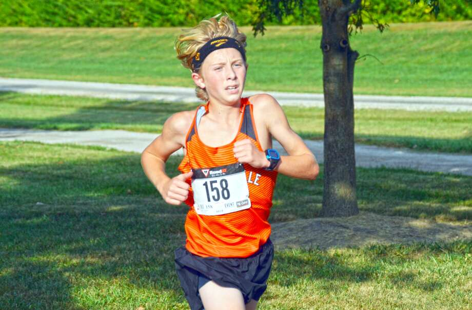 Edwardsville's Jack Perulfli runs the second mile of Tuesday's Madison County Meet at Alhambra's City Park.