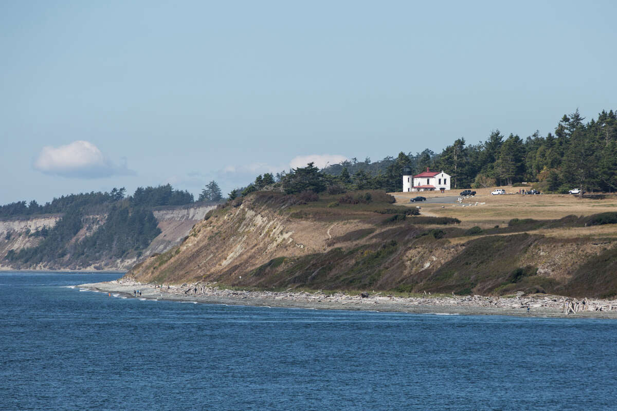 A lighthouse looks over the Puget Sound, seen from the Coupeville to Port Townsend ferry on Aug. 31, 2017.