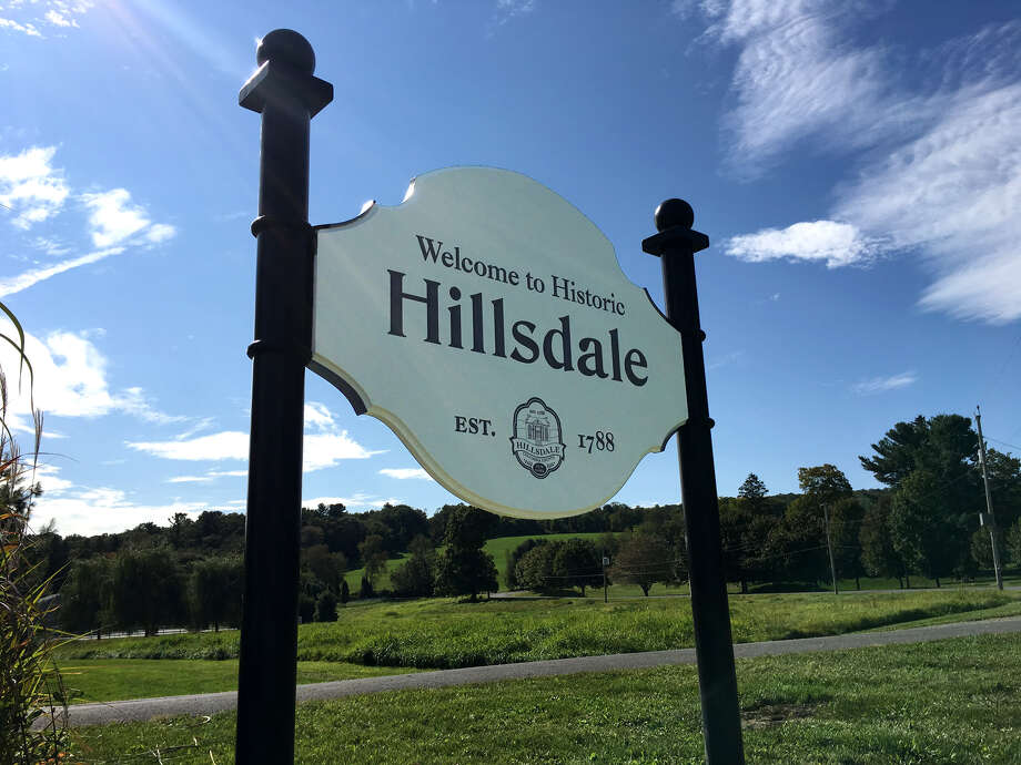 The Columbia County town of Hillsdale shows off its new signs to welcome visitors to its hamlet, which is listed on the National Register of Historic Places. The signs replace ones that were more than 25 years old. The typeface is based on the nameplate of a Hillsdale newspaper from the early 1900s. Donations from residents paid for the signs, which were crafted by two Columbia County businesses. (Bart Ziegler)