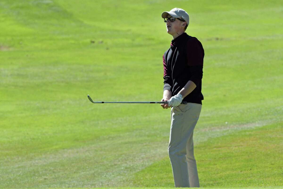 Adam Desorbo of Fonda Fultonville High School watches his chip shot during the Section II golf championships at McGregor Links on Tuesday, Oct. 3, 2017, in Wilton, N.Y. (Paul Buckowski / Times Union)