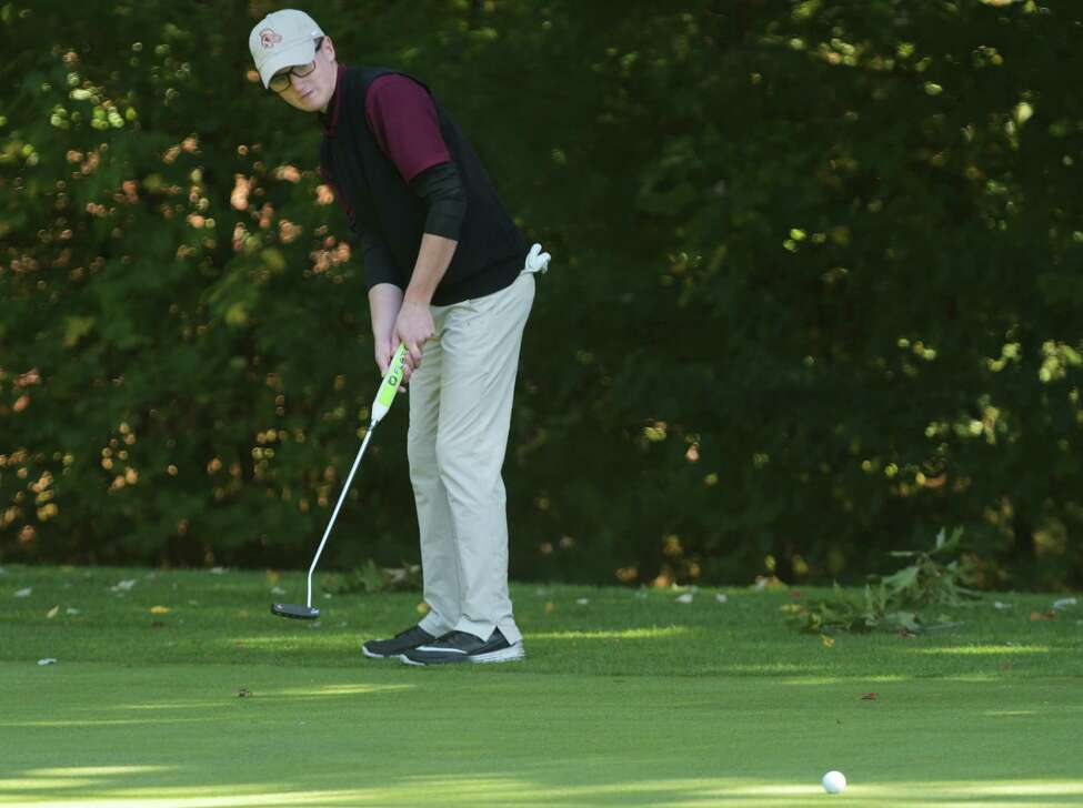 Adam Desorbo of Fonda Fultonville High School hits a putt towards the cup during the Section II golf championships at McGregor Links on Tuesday, Oct. 3, 2017, in Wilton, N.Y. (Paul Buckowski / Times Union)