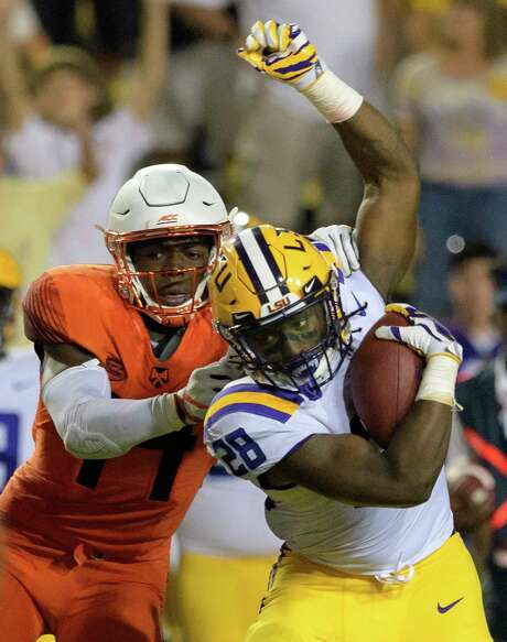 Syracuse defensive back Evan Foster (14) tangles with LSU running back Darrel Williams (28) during an NCAA college football game in Baton Rouge, La., Saturday, Sept. 23, 2017. (AP Photo/Matthew Hinton) Photo: Matthew Hinton, FRE / © 2017 MATTHEW HINTON