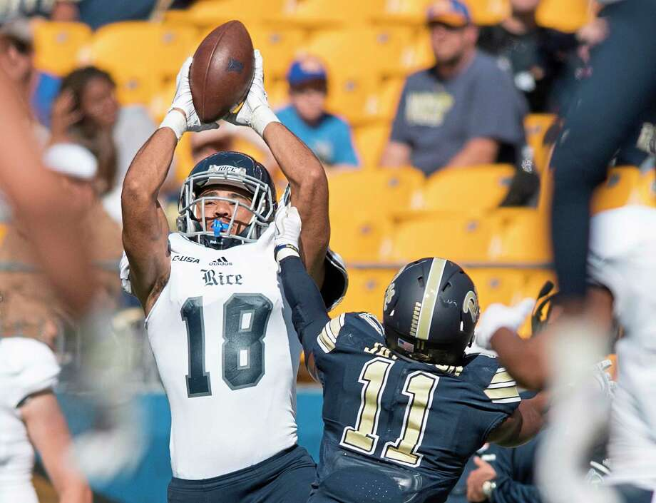 Rice's Kylen Granson (18) catches a pass over Pittsburgh defensive back Dane Jackson (11) on Saturday, Sept. 30, 2017, at Heinz Field in Pittsburgh. The host Panthers won, 42-10. (Steph Chambers/Pittsburgh Post-Gazette/TNS) Photo: Steph Chambers, MBR / Pittsburgh Post-Gazette