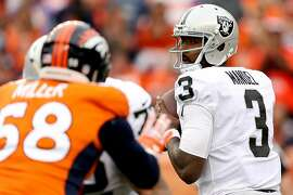 DENVER, CO - OCTOBER 01:  Backup quarterback EJ Manuel #3 of the Oakland Raiders throws against the Denver Broncos at Sports Authority Field at Mile High on October 1, 2017 in Denver, Colorado.  (Photo by Matthew Stockman/Getty Images)