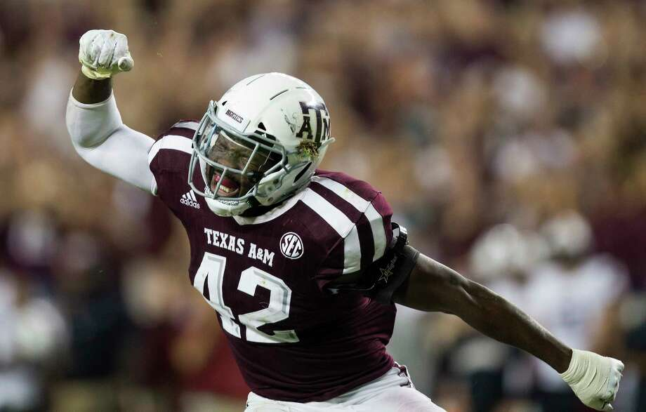 Texas A&M linebacker Otaro Alaka (42) reacts after sacking South Carolina quarterback Jake Bentley during the fourth quarter of an NCAA college football game Saturday, Sept. 30, 2017, in College Station, Texas. (AP Photo/Sam Craft) Photo: Sam Craft, FRE / AP