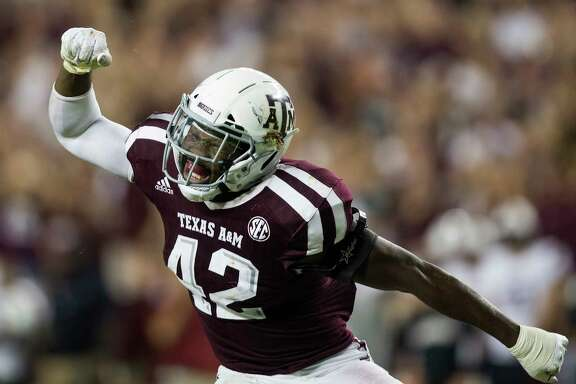 Texas A&M linebacker Otaro Alaka (42) reacts after sacking South Carolina quarterback Jake Bentley during the fourth quarter of an NCAA college football game Saturday, Sept. 30, 2017, in College Station, Texas. (AP Photo/Sam Craft)