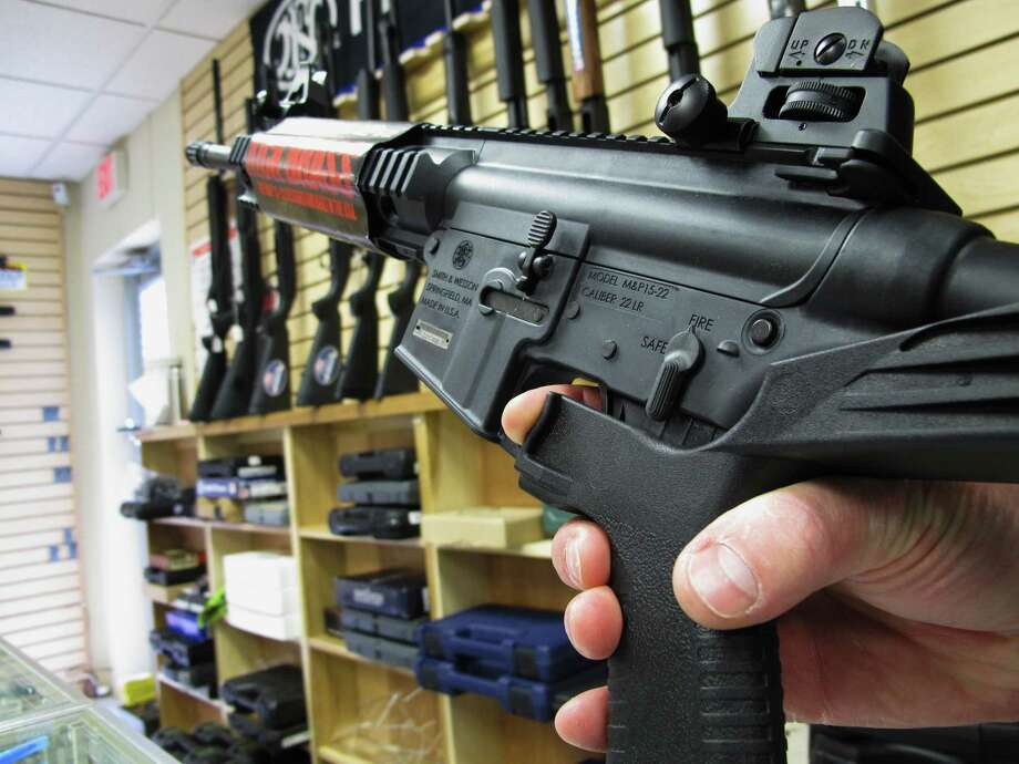 "An employee of a Raleigh, N.C., gun store demonstrates how a ""bump stock"" works. The mechanism allows semi-automatic rifles to fire faster. Photo: Allen Breed, STF / Copyright 2017 The Associated Press. All rights reserved."