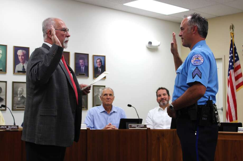 Barry Jones of the Edwardsville Police Department was sworn in by City Clerk Dennis McCracken as a new police sergeant for the city of Edwardsville at Tuesday's City Council meeting. Photo: Cody King • Cking@edwpub.net