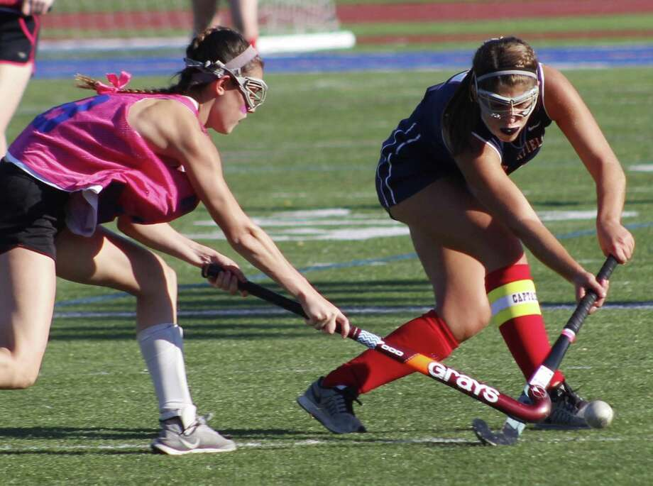 Brookfield's Brittney Ek, left, and New Fairfield's Shannon Broderick battle for possession of the ball during the field hockey game at Brookfield High School Oct. 3, 2017. Photo: Richard Gregory / Richard Gregory