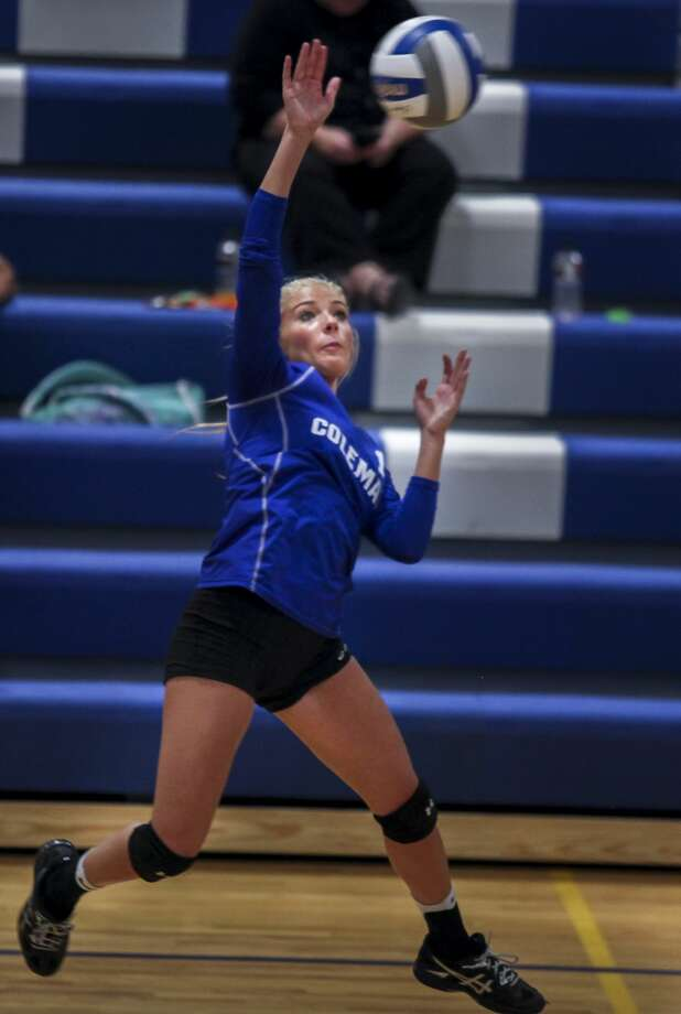 Coleman's Makailyn Monson jumps into the air as she hits during Coleman's volleyball game against Breckenridge at Coleman Junior and Senior High School in Coleman on Tuesday, Oct. 3, 2017. (Josie Norris/for the Daily News) Photo: Josie Norris/Midland Daily News, (Josie Norris/for The Daily News)