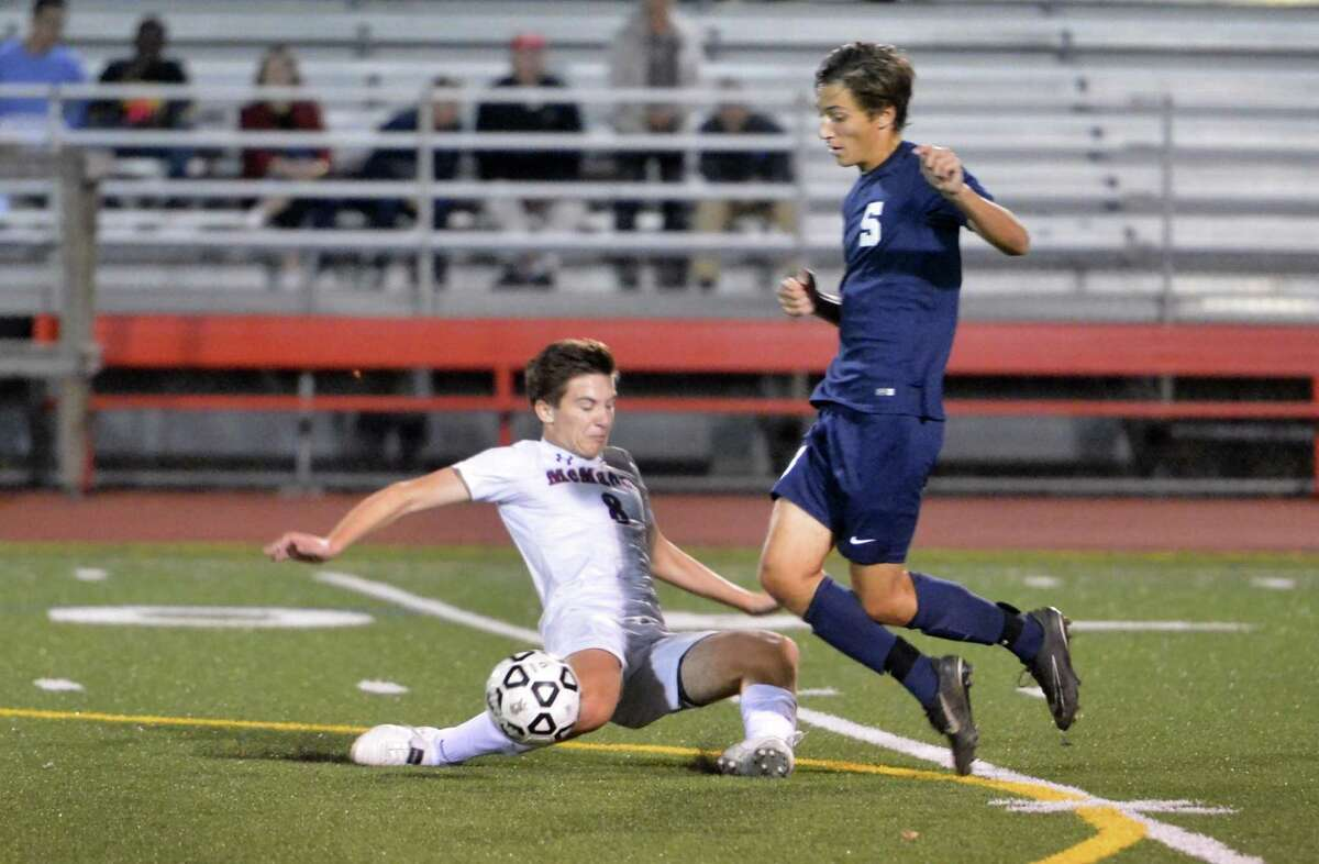 Brien McMahon's #8 George Simpson gets the ball away from Staples defender #18 Matt Engler during boys soccer action at Brien McMahon High School on Tuesday October 3, 2017 in Norwalk Conn.
