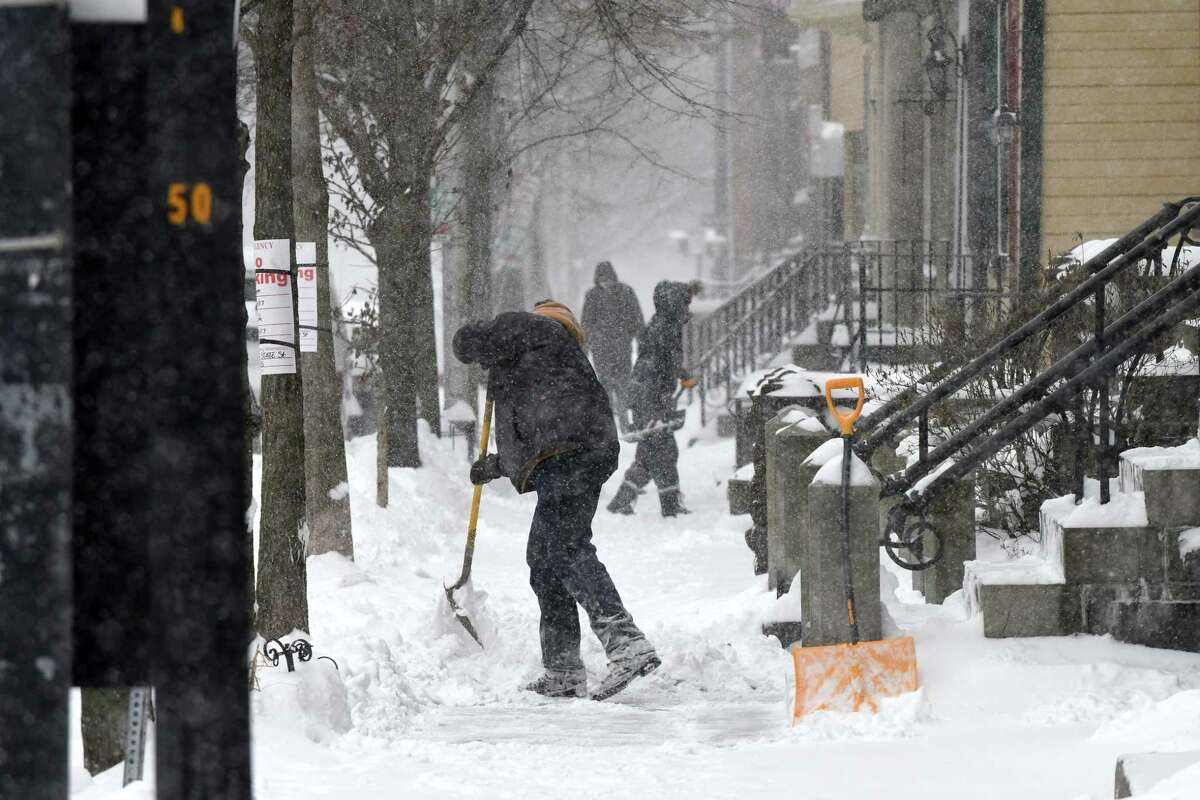 Snow is cleared from the sidewalk on State Street on Thursday, Feb. 9, 2017, in Albany, N.Y. (Will Waldron/Times Union)