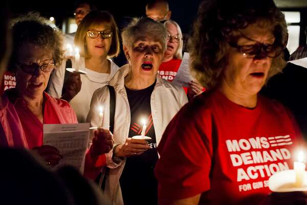 People sing Amazing Grace during a candlelight vigil for victims of the mass shooting which took place Sunday, Oct. 1 in Las Vegas, on Tuesday, Oct. 3, 2017 at Unitarian Universalist Fellowship of Midland. (Katy Kildee/kkildee@mdn.net)