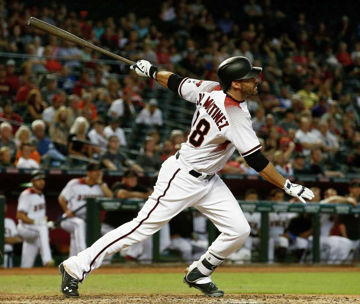 FILE - In this Sept. 27, 2017, file photo, Arizona Diamondbacks' J.D. Martinez, right, watches the flight of his home run against the San Francisco Giants during the ninth inning of a baseball game in Phoenix. Martinez has had a thunderous last half to the season, and it only picked up steam down the stretch. (AP Photo/Ross D. Franklin, File) ORG XMIT: NY161