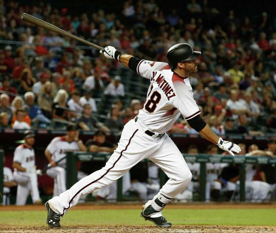 FILE - In this Sept. 27, 2017, file photo, Arizona Diamondbacks' J.D. Martinez, right, watches the flight of his home run against the San Francisco Giants during the ninth inning of a baseball game in Phoenix. Martinez has had a thunderous last half to the season, and it only picked up steam down the stretch. (AP Photo/Ross D. Franklin, File) ORG XMIT: NY161 Photo: Ross D. Franklin / Copyright 2017 The Associated Press. All rights reserved.
