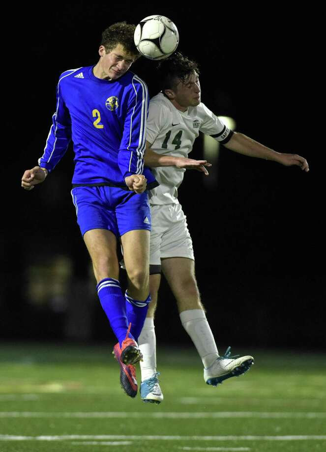 Newtown's Grant Moxham (2) and New Milford's Shane Fedigan (14) head the ball in the boys soccer game between Newtown and New Milford high schools, on Tuesday night, October 3, 2017, at New Milford High School, in New Milford, Conn. Photo: H John Voorhees III / Hearst Connecticut Media / The News-Times