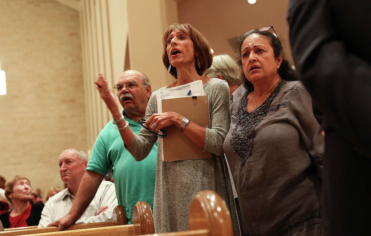 Susan Gwinnell, who was flooded out of her home, listens to public comment during town hall meeting at St. John Vianney Catholic Church for Harvey response on Tuesday, Oct. 3, 2017, in Houston.