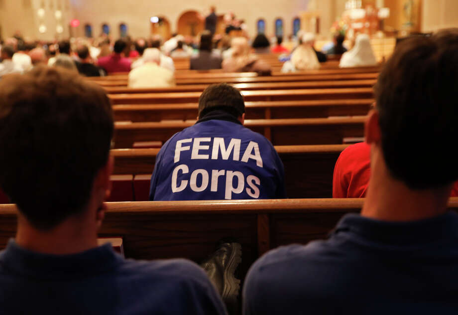 FEMA employees listen to a  town hall meeting at St. John Vianney Catholic Church on Tuesday, Oct. 3, 2017, in Houston.See areas of the city hardest hit by Hurricane Harvey Photo: Elizabeth Conley, Houston Chronicle / © 2017 Houston Chronicle