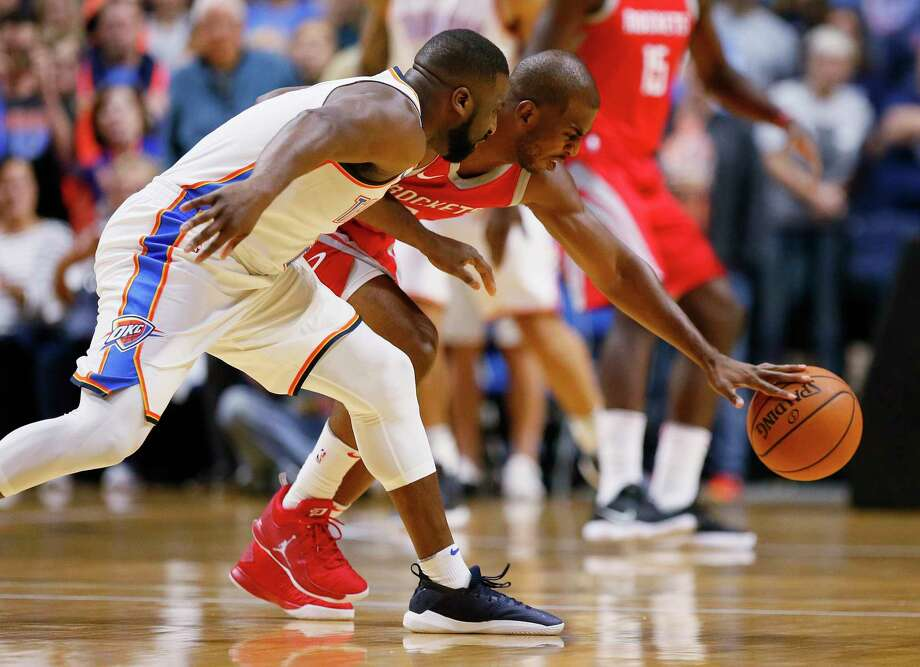 Houston Rockets guard Chris Paul, right, steals the ball from Oklahoma City Thunder guard Raymond Felton, left, during the first quarter an NBA preseason basketball game in Tulsa, Okla., Tuesday, Oct. 3, 2017. (AP Photo/Sue Ogrocki) Photo: Sue Ogrocki, Associated Press / AP2017