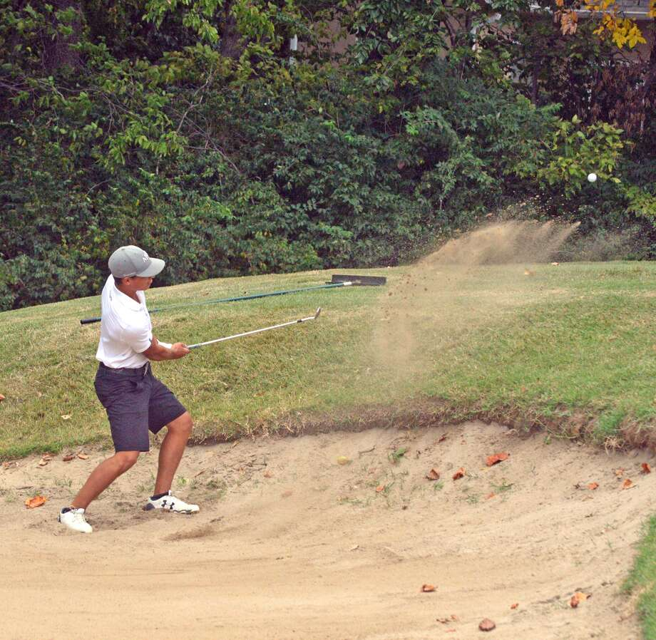 Edwardsville senior Ben Tyrrell hits his way out of a sand trap on hole No. 4 at Clinton Hill Golf Course during Tuesday's Class 3A Belleville East Regional.