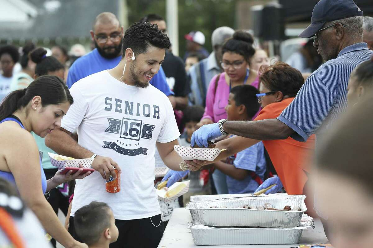 Barbecue is served as local residents meet at the Davis-Scott YMCA for National Night Out activities Tuesday.