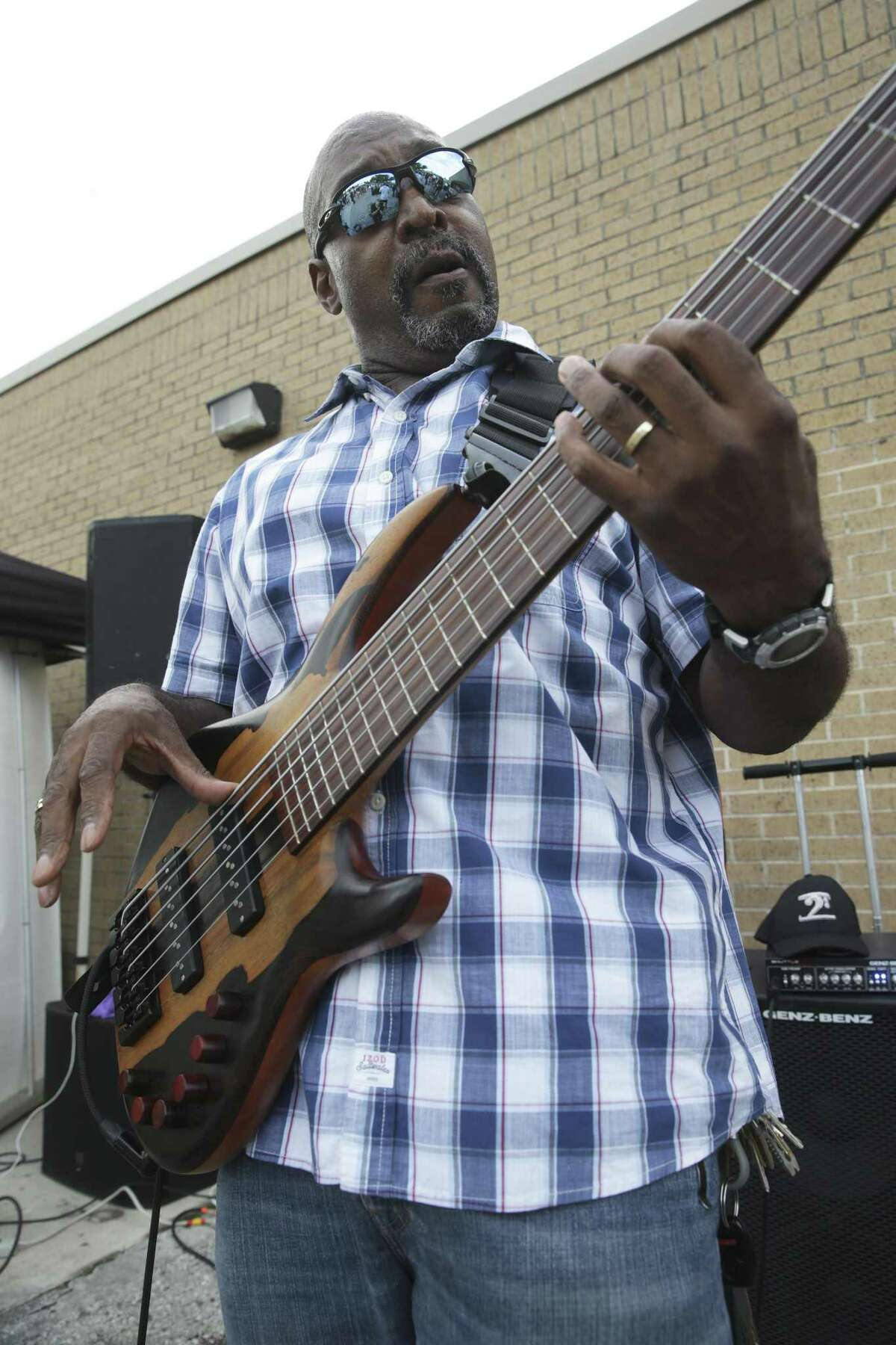 Mike McLean plays bass guitar for the Billy Ray Sheppard Band on Tuesday for National Night Out activities at the Davis-Scott YMCA.