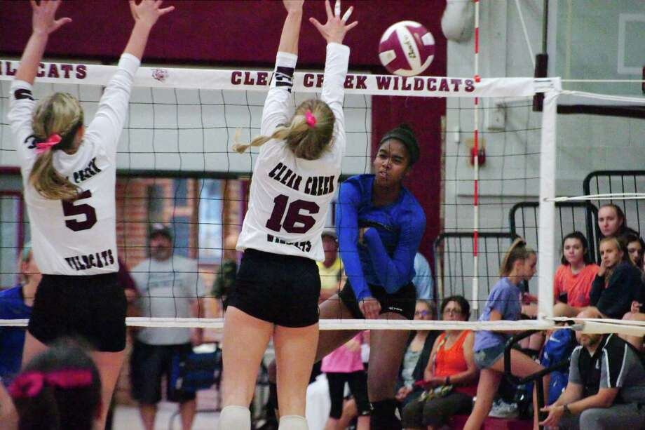 Clear Creek's Riley Brantley (5) and Clear Creek's Kelsey Childers (16) go high to block a shot by Clear Springs' Shyia Richardson (8) Tuesday, Oct. 4 at Clear Creek High School. Photo: Kirk Sides / © 2017 Kirk Sides / Houston Chronicle