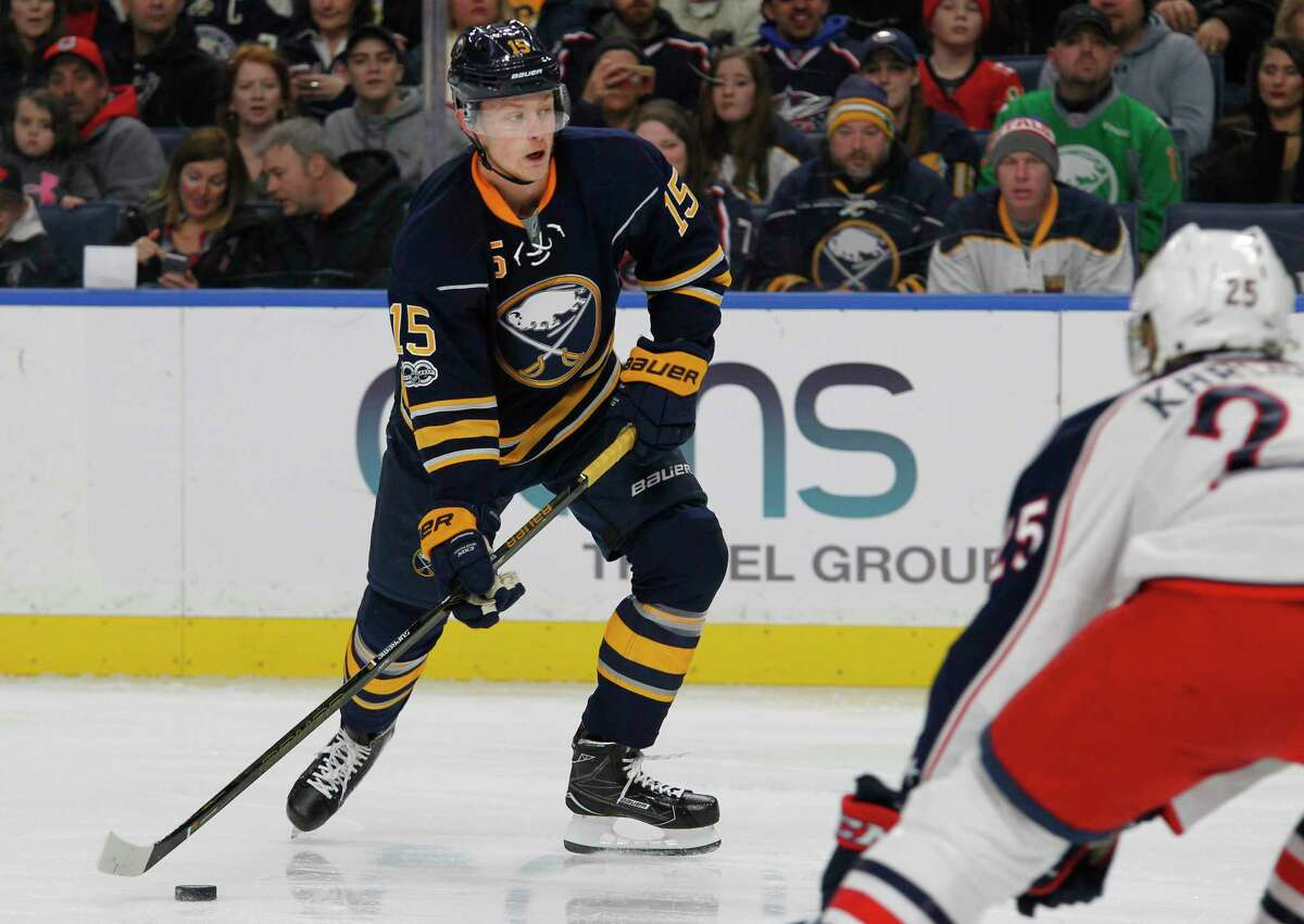 """FILE - In this March 11, 2017, file photo, Buffalo Sabres forward Jack Eichel (15) controls the puck during the first period of an NHL hockey game against the Columbus Blue Jackets in Buffalo, N.Y. Eichel called his first two NHL seasons as being """"mediocre"""" upon arriving at training camp last month. There's nothing substandard about the eight-year, $80-million contract extension the 20-year-old center agreed to on Tuesday, Oct. 3. The deal was reached two days before the Sabres open the season hosting Montreal. And it ended months of negotiations while coming after talks had stalled over the past six weeks. The extension won't kick in until next season. (AP Photo/Jeffrey T. Barnes, File) ORG XMIT: NY197"""