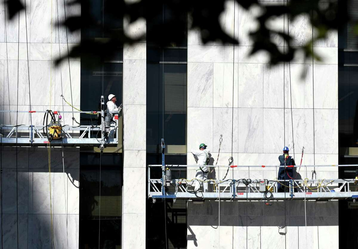 Workers makes repairs to seems in the marble faced of the Swan Street Building at Empire State Plaza on Tuesday, Oct. 3, 2017, in Albany, N.Y. (Will Waldron/Times Union)