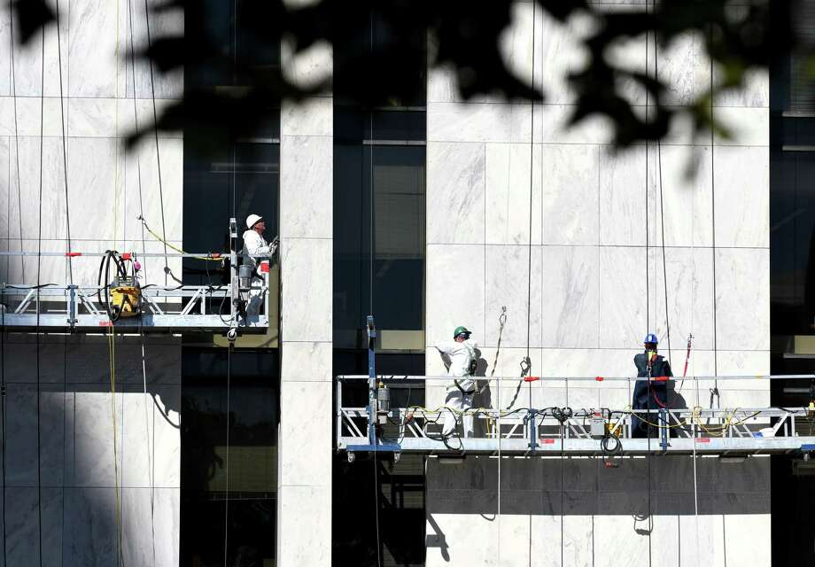Workers makes repairs to seems in the marble faced of the Swan Street Building at Empire State Plaza on Tuesday, Oct. 3, 2017, in Albany, N.Y. (Will Waldron/Times Union) Photo: Will Waldron
